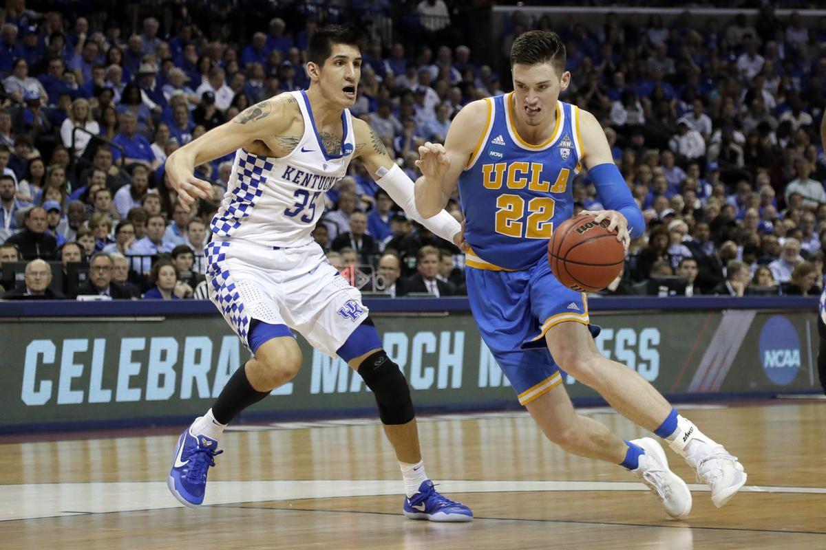 UCLA forward TJ Leaf (22) drives against Kentucky forward Derek Willis (35) in the second half of an NCAA college basketball tournament South Regional semifinal game Friday, March 24, 2017, in Memphis, Tenn.