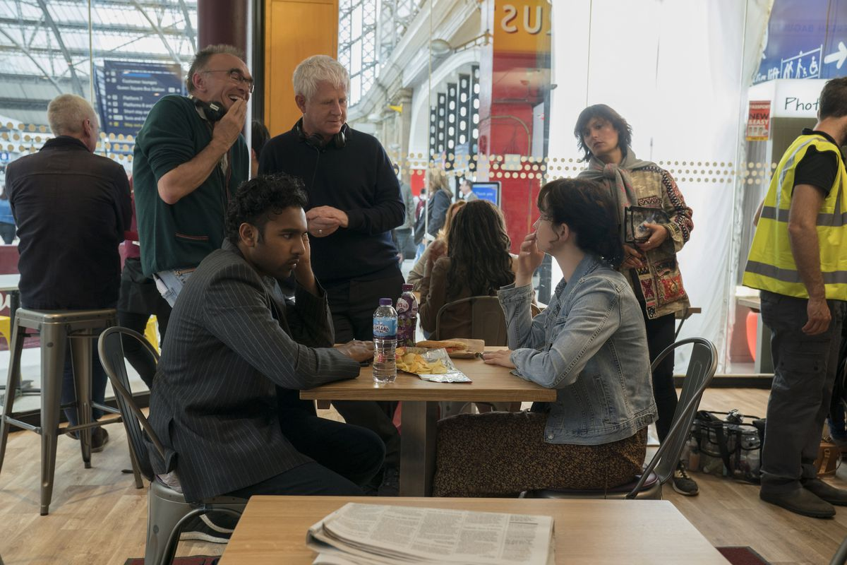 Danny Boyle, screenwriter Richard Curtis, Himesh Patel and Lily James (front, seated) on the set of Yesterday