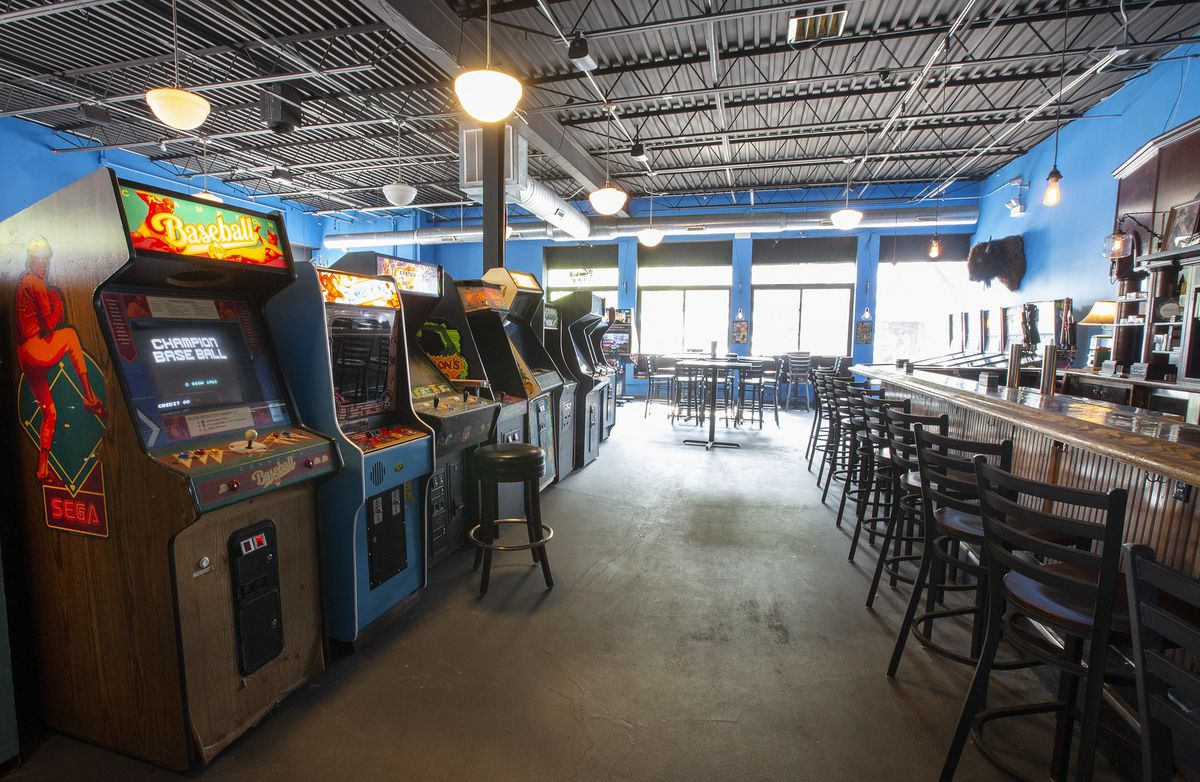 a row of video games and a carved wooden bar