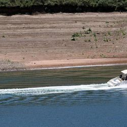 People tube behind a boat on East Canyon Reservoir on Tuesday, June 25, 2013. Utah is facing drought conditions this summer.