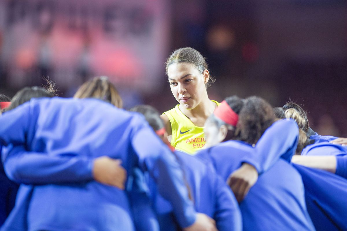 Liz Cambage in a team huddle