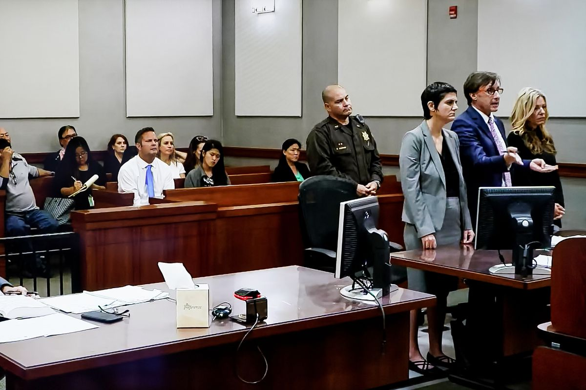 Lori Vallow, aka Lori Daybell, right, appears in court in Kauai, Hawaii on Friday, Feb. 21, 2020. Seated in the gallery is her husband, Chad Daybell, front row in blue tie.