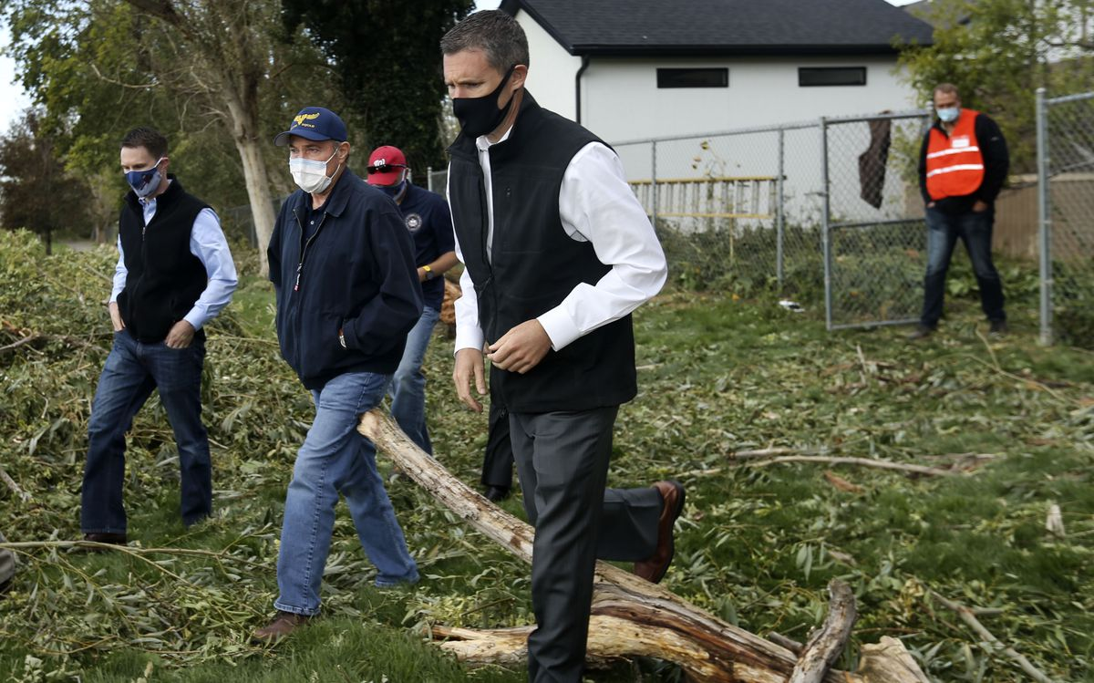 Gov. Gary Herbert, center, and other officials survey the damage caused by hurricane-force winds in Centerville on Wednesday, Sept. 9, 2020. The massive windstorm that took out thousands of trees from Cache County to Utah County on Tuesday left nearly 200,000 customers without power.
