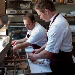 Matthew Sigler and Thomas McNaughton make the first sandwiches
