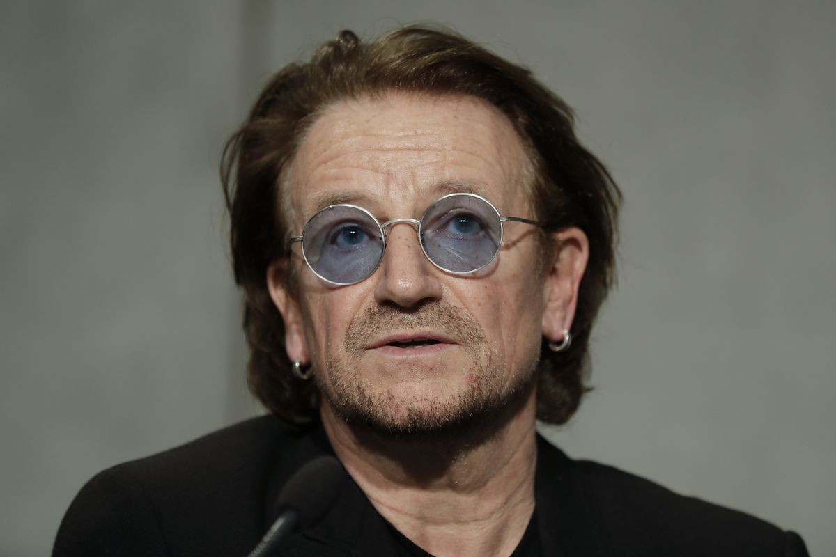 U2 rock band frontman Bono Vox talks to reporters during a press conference he held at the end of a meeting with Pope Francis at the Vatican, Wednesday, Sept. 19, 2018.