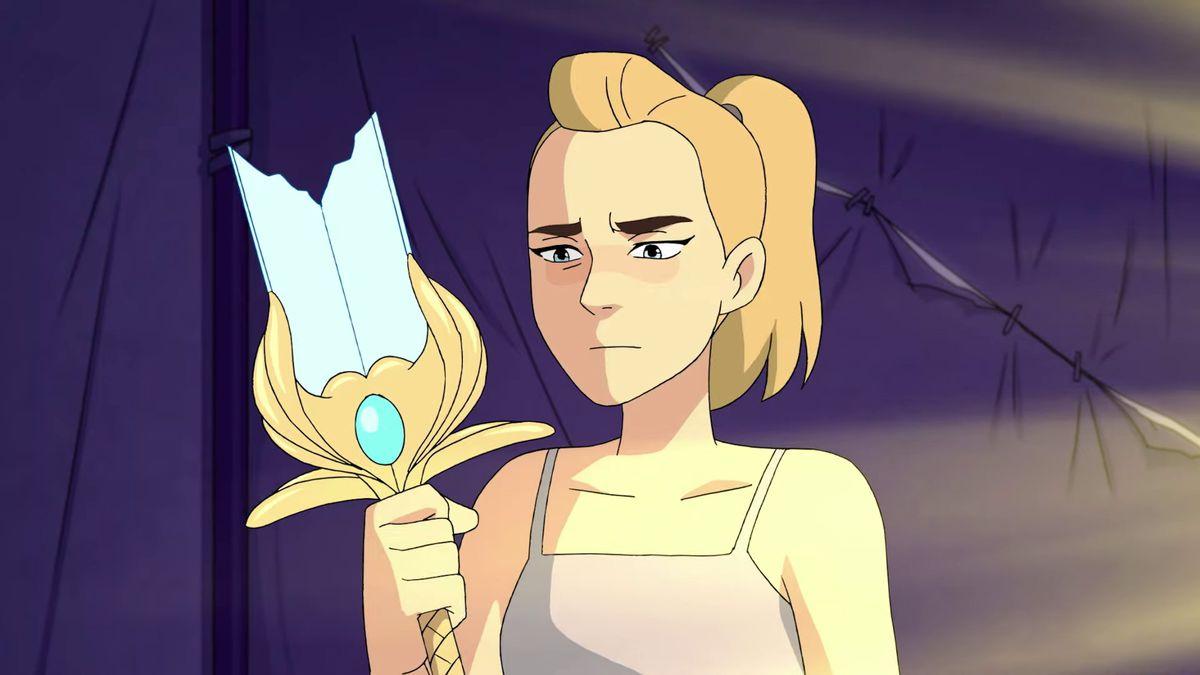 adora looking forlornly at her broken sword