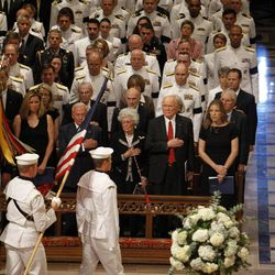 From right to left, singer Diana Krall, astronaut, and former Ohio Sen. John Glenn, his wife Annie,  and astronaut Buzz Aldrin, stand during the processional at the Washington National Cathedral in Washington, Thursday, Sept. 13, 2012,  during a national memorial service for the first man to walk on the moon, Neil Armstrong.