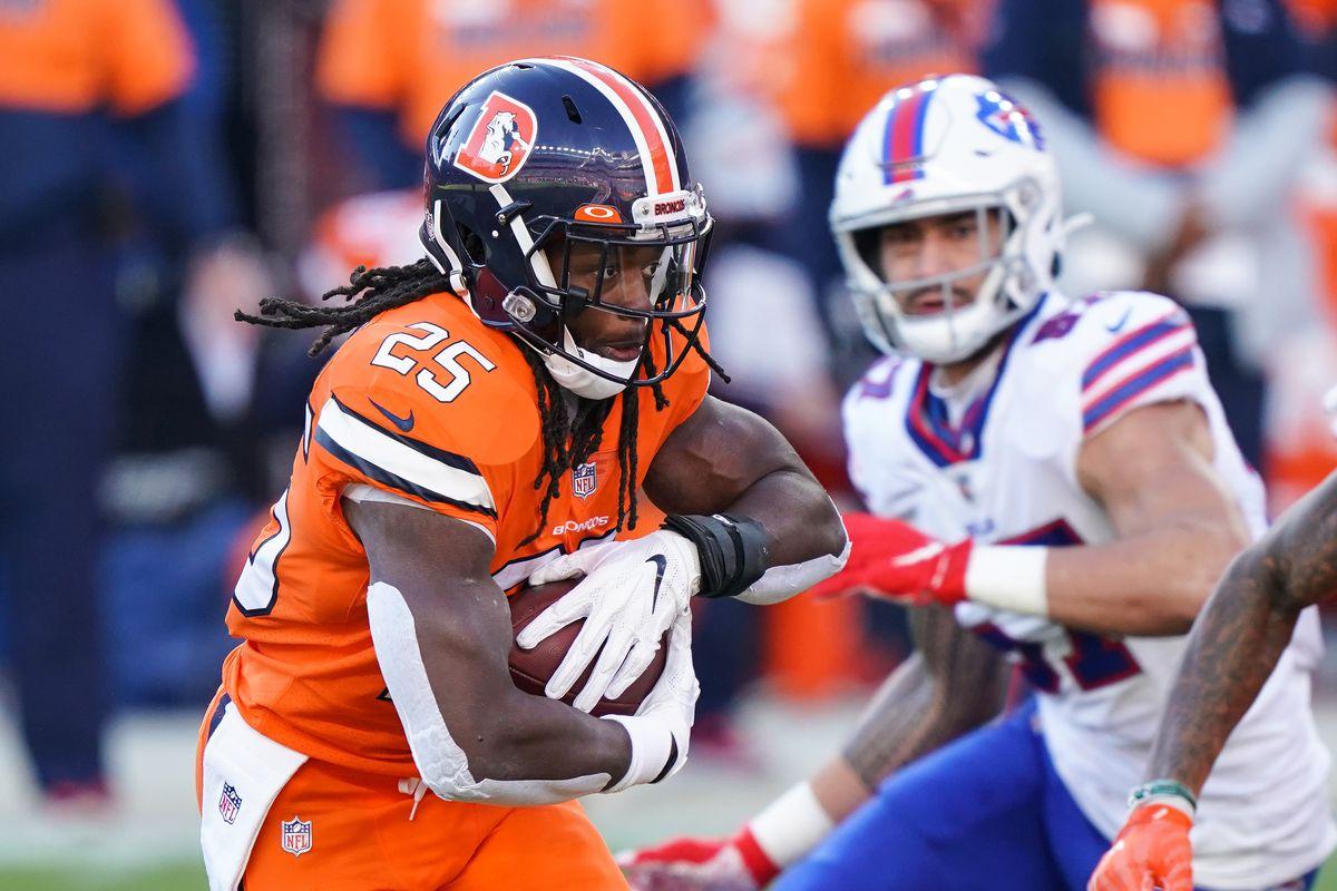 Dec 19, 2020; Denver, Colorado, USA; Denver Broncos running back Melvin Gordon (25) runs against the Buffalo Bills during the first quarter at Empower Field at Mile High. Mandatory Credit: Troy Babbitt