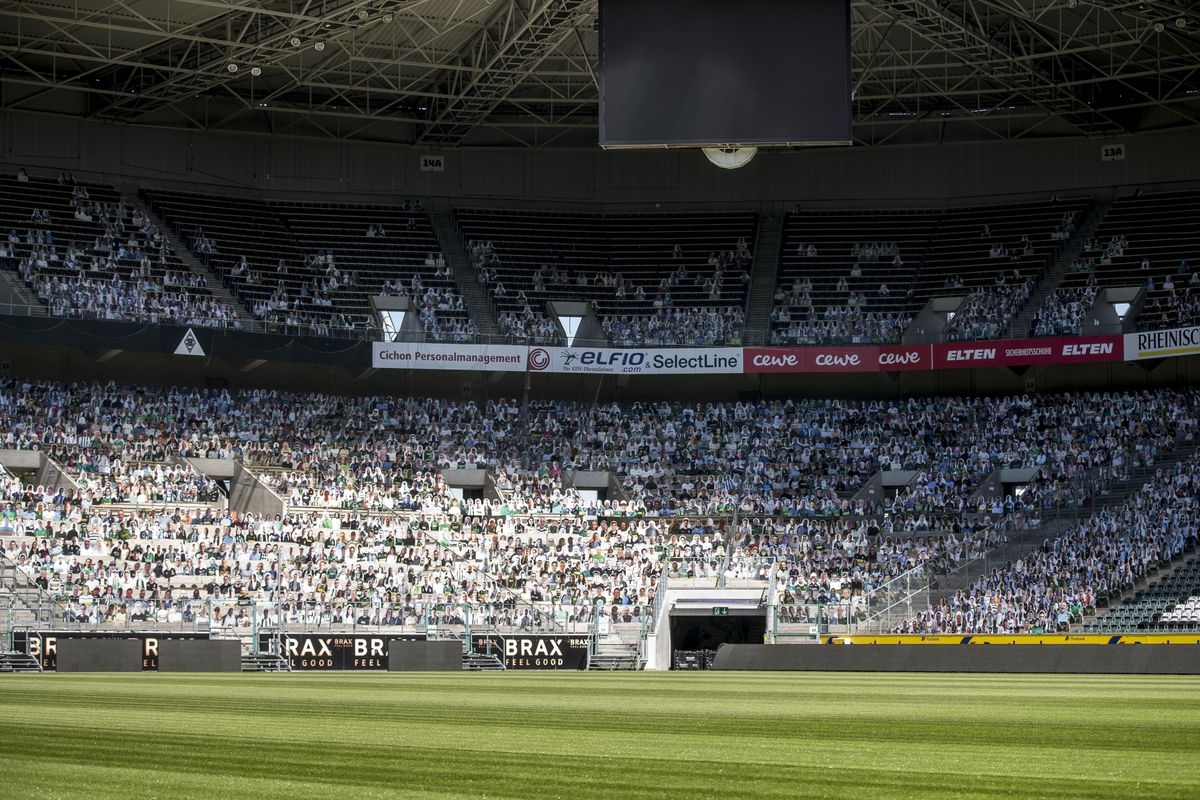 Cardboard cut-outs of fans of Bundesliga club Borussia Moenchengladbach fill their stadium on May 14, 2020 in Moenchengladbach, Germany. Borussia Moenchengladbach supporters sustain their club by buying cardboard characters, so called 'Pappkameraden', that will be printed and then displayed at the stadium should the Bundesliga continue with matches that will be played behind closed doors.