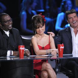"""FILE - In this April 6, 2008 file photo, Randy Jackson, left, Paula Abdul, center, and Simon Cowell sit by the stage at the """"Idol Gives Back"""" fundraising special of """"American Idol"""" in Los Angeles. Jackson, Abdul and Cowell were the original judges on """"American Idol."""" The cast of judges has changed over the years, with Jackson now the lone judge left from the first season. On Sunday, Sept. 16, 2012, singer-rapper Nicki Minaj and country crooner Keith Urban were named as judges, joining Mariah Carey and Jackson, as the judges' panel has now expanded to four members from its previous three."""