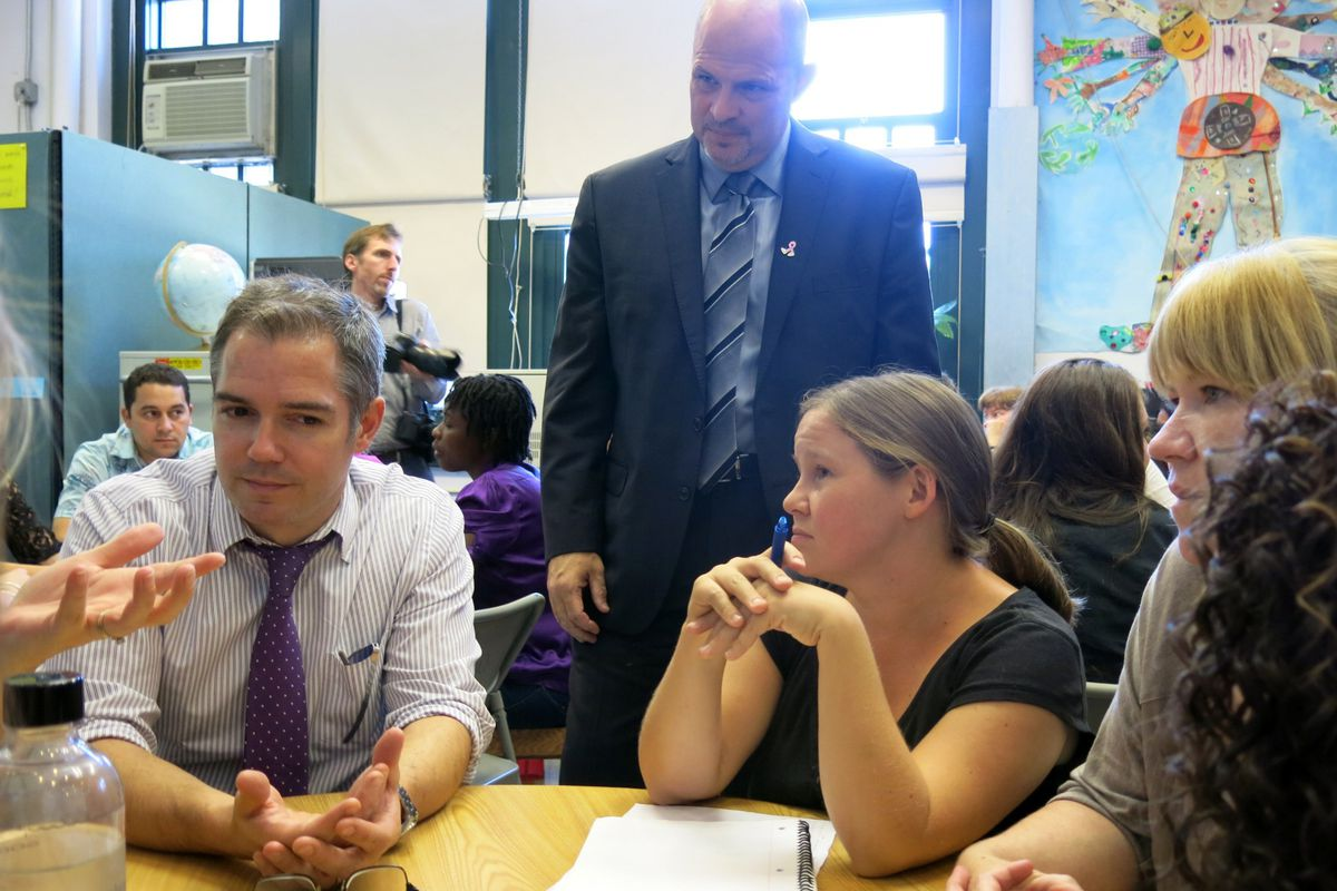 UFT President Michael Mulgrew (standing) met with teachers during a school visit in 2014.