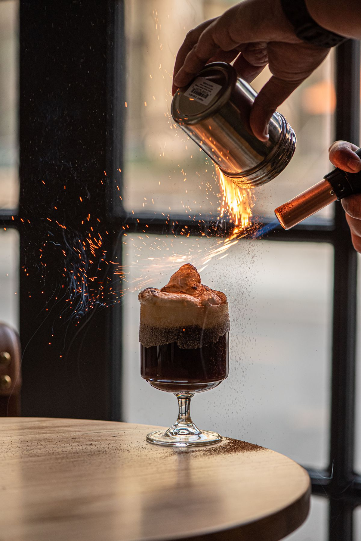 A coffee liqueur cocktail with cinnamon fire shown above.