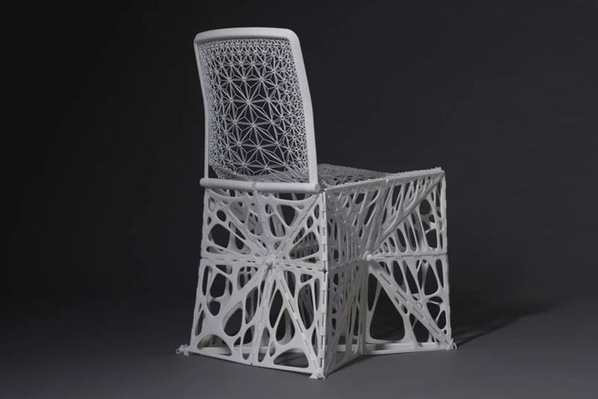 White 3D-printed chair with web pattern