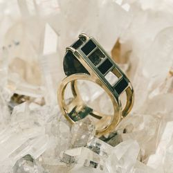 "Crosscut ring, <a href=""http://www.aeajewelry.com/shop-all/crosscut-ring-1"">$1,750</a>"