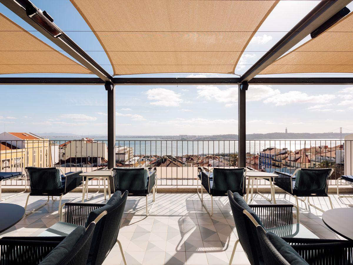 A shaded patio overlooking Lisbon