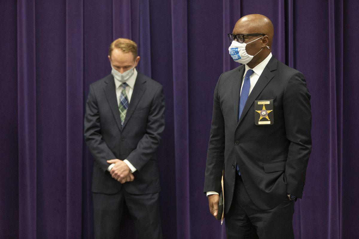 Chicago Police Supt. David Brown (right) and Police Bureau of Detectives Chief Brendan Deenihan appear at a press conference at Chicago Police Department headquarters on June 22, 2020.