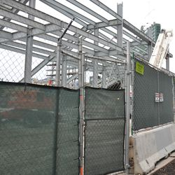 A work employee gate is installed along the Sheffield Avenue fence -