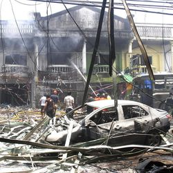 Thai firefighters and soldiers work at the site of a car bomb  attack in Yala province, southern Thailand, on Saturday.