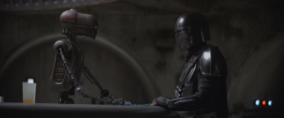 The Mandalorian and the droid proprietor of the Mos Eisley spaceport cantina.