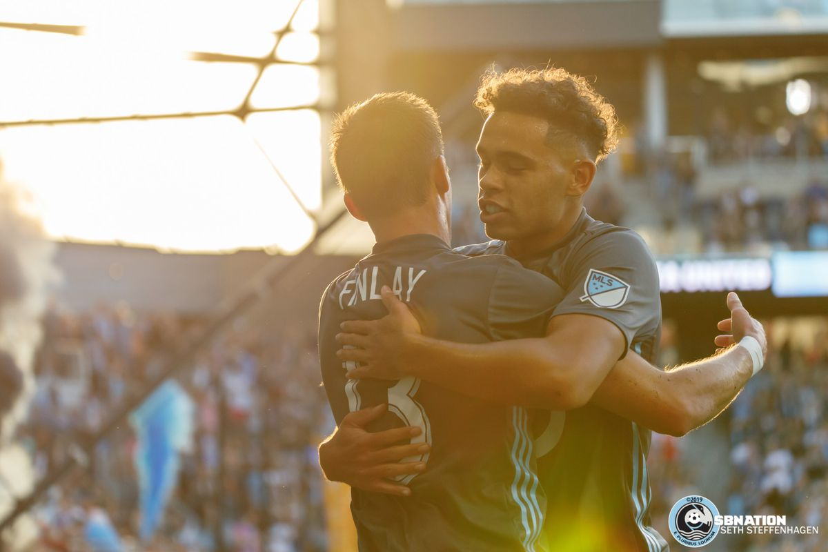 September 15, 2019 - Saint Paul, Minnesota, United States - Minnesota United midfielder Ethan Finlay (13) celebrates with team mate Hassani Dotson (31) after scoring a goal against Real Salt Lake at Allianz Field.