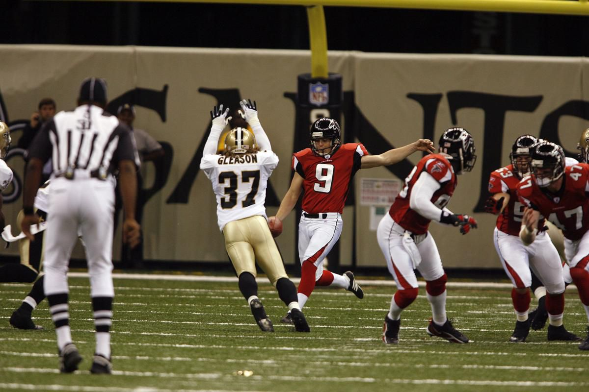 Saints' Steve Gleason (37) goes high to block the kick of Falcons' punter Michael Koenen (9) during first half action. The Saints recovered and scored soon after.