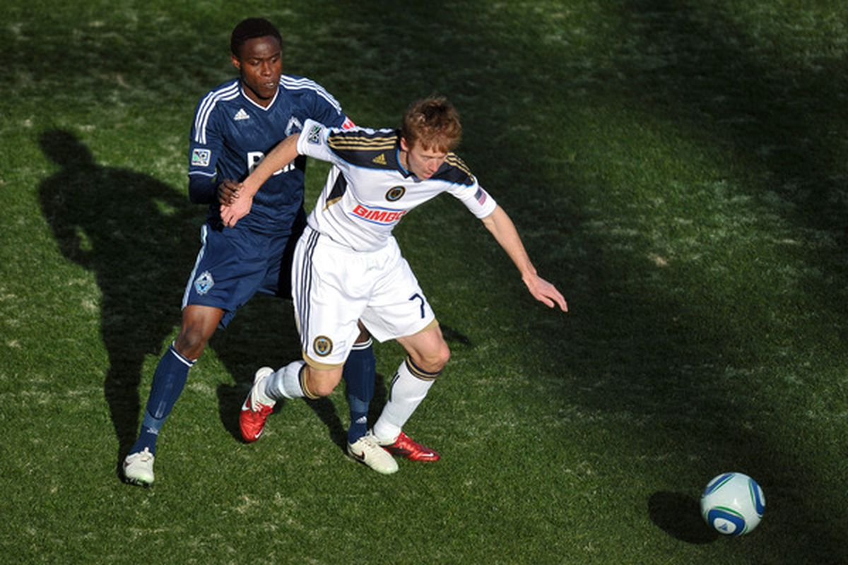 CHESTER, PA- MARCH 26: Gershon Koffie #28 of the Vancouver Whitecaps and Brian Carroll #7 of the Philadelphia Union fight for the ball at PPL Park on March 26, 2011 in Chester, Pennsylvania. (Photo by Drew Hallowell/Getty Images)