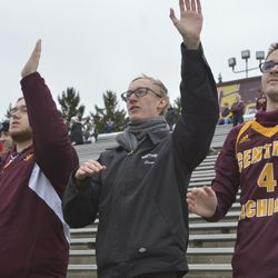 Students participate in the alma mater hand claps.