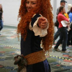 Kellynn Flanders of Roy dressed as Pixar's Merida at Salt Lake Comic Con. With more than 50,000 tickets sold, Comic Con goers filled the convention halls to the max during the final day of the convention.