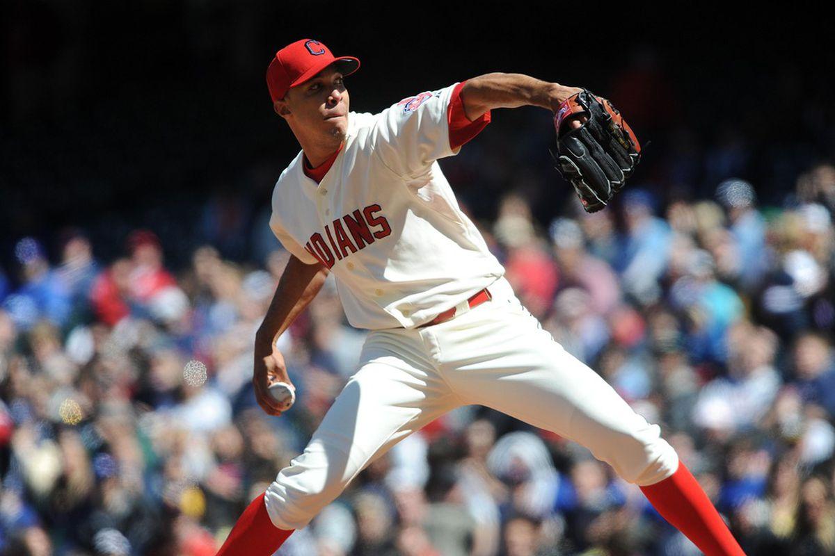 April 7, 2012; Cleveland, OH, USA: Cleveland Indians starting pitcher Ubaldo Jimenez (30) pitches during the sixth inning against the Toronto Blue Jays at Progressive Field.  Mandatory Credit: Eric P. Mull-USPRESSWIRE