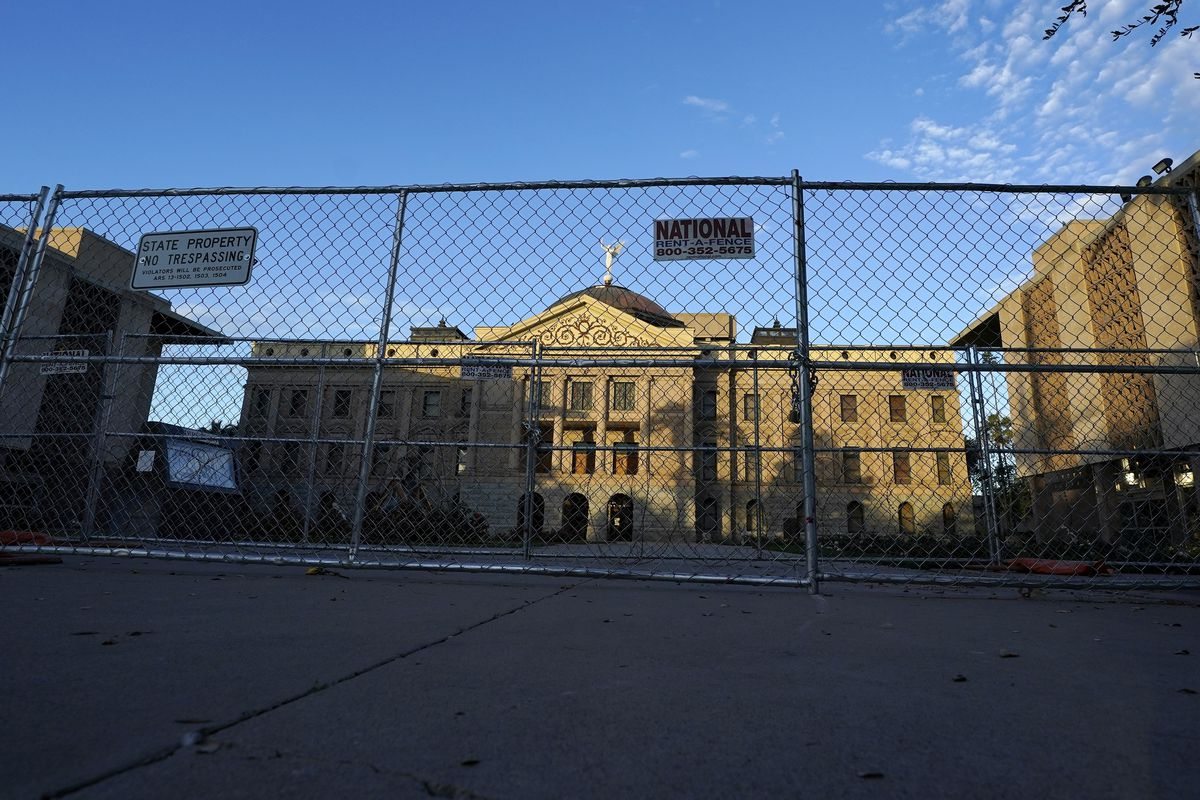 Two layers of security fencing is shown encircling the Arizona Capitol Saturday, Jan. 16, 2021, in Phoenix.