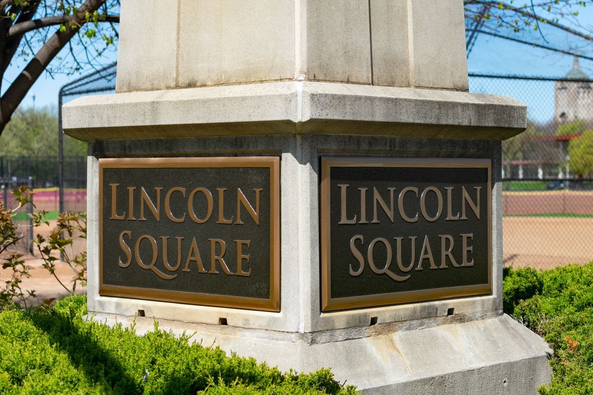 """A monument with the words """"Lincoln Square."""""""