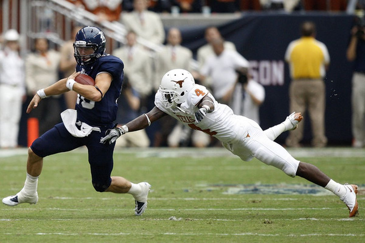 HOUSTON - SEPTEMBER 04:  Quarterback Taylor McHargue #16 of the Rice Owls avoids diving cornerback Aaron Williams #4 of the Texas Longhorns at Reliant Stadium on September 4 2010 in Houston Texas.  (Photo by Bob Levey/Getty Images)