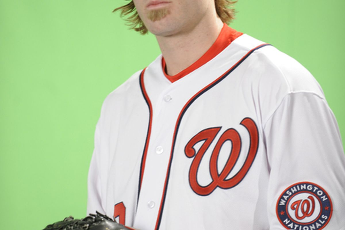 WASHINGTON DC - DECEMBER 15:  Jayson Werth #28 of the Washington Nationals poses before being introduced to the media on December 15 2010 at Nationals Park in Washington DC.  (Photo by Mitchell Layton/Getty Images)