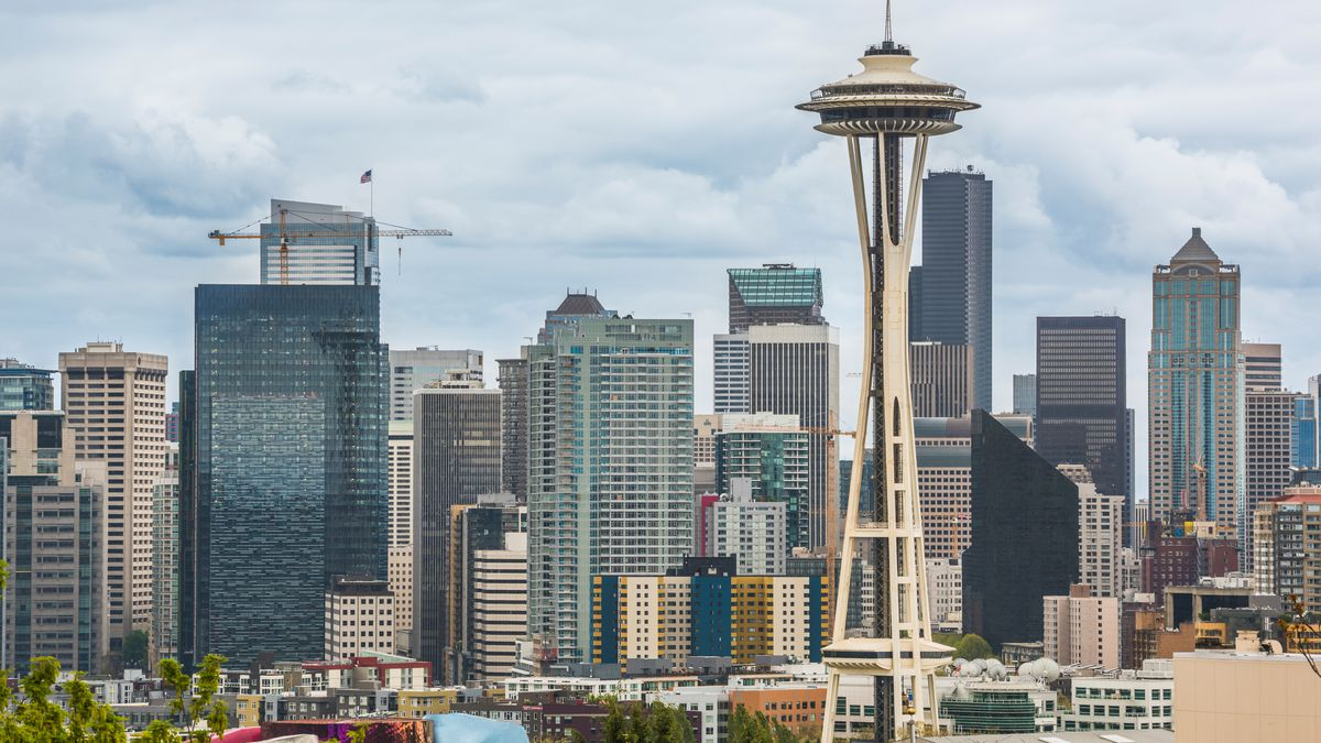 The Seattle skyline showing the Space Needle prominently on a cloudy day.