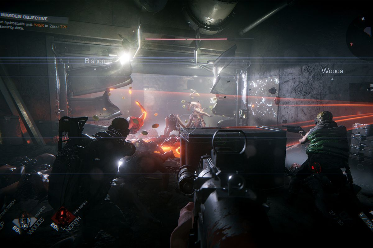 Players behind barricades fight off a horde or Sleepers. A turret scans the room on the right.