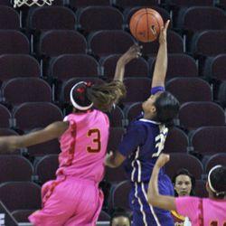 Desiree Bradley swats away a shot.
