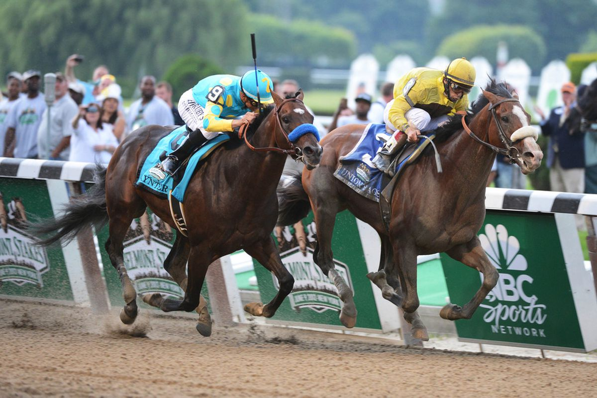 June 9, 2012; Elmont, NY, USA; John Velazquez aboard Union Rags (3) takes the lead over Mike Smith aboard Paynter (9) to win the 144th running of Belmont Stakes at Belmont Park. Mandatory Credit: Richard Mackson-US PRESSWIRE