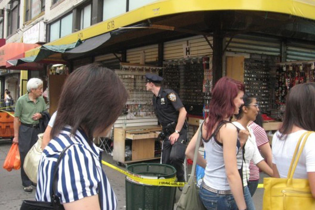 """A 2008 Canal Street <a href=""""http://ny.racked.com/archives/2008/06/23/busted_more_counterfeiters_hit.php"""">bust</a> in action"""