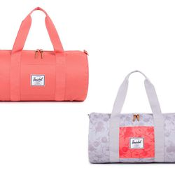 """Sutton mid-volume duffle, <a href=""""http://shop.herschelsupply.com/collections/duffle/products/sutton-duffle-mid-volume-flamingo"""">Herschel Supply Co.</a>, $54.95."""