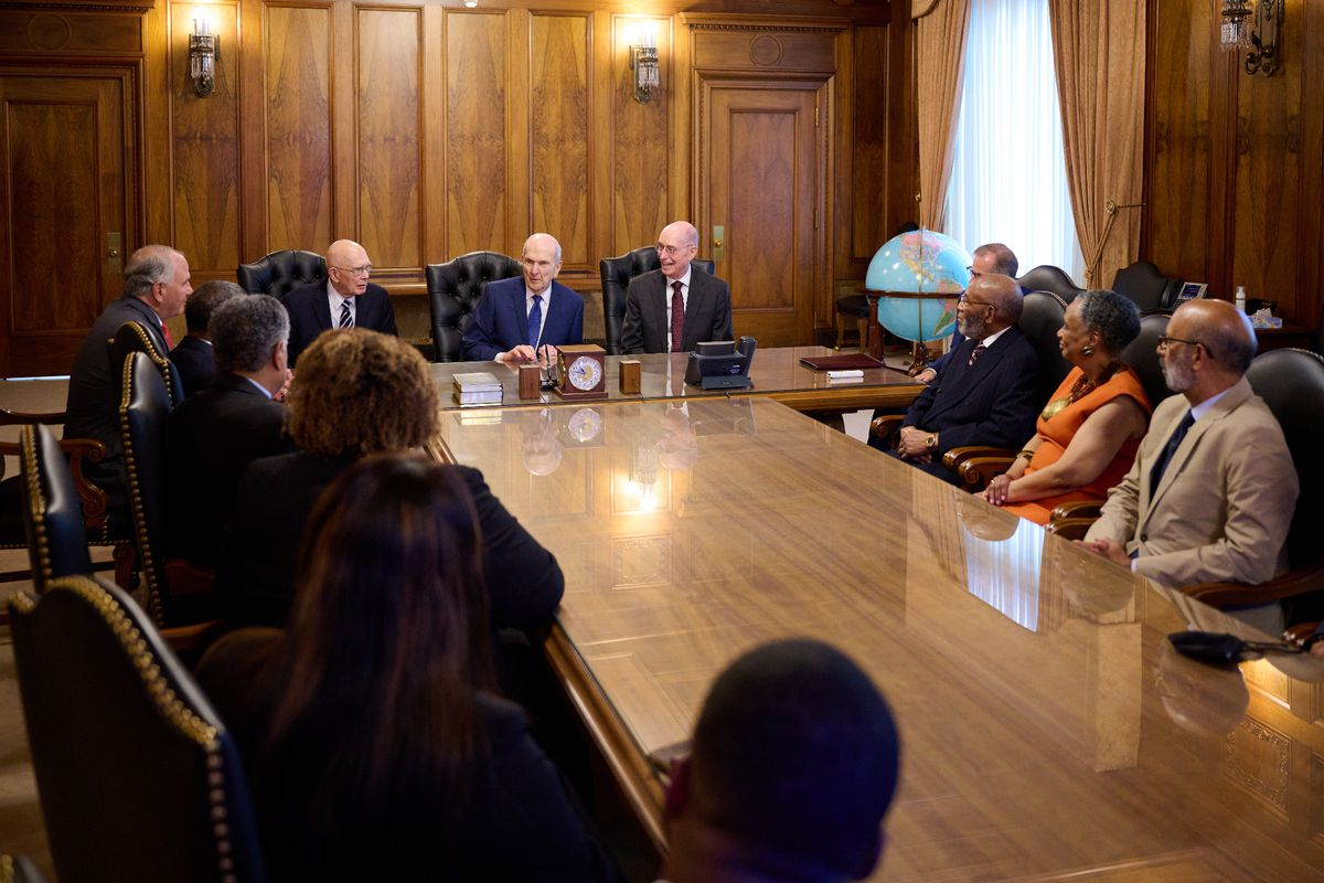 Leaders of The Church of Jesus Christ of Latter-day Saints, NAACP and United Negro College Fund sit around a boardroom table.