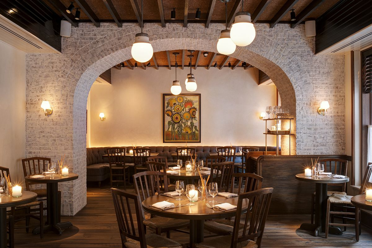 restaurant interior with white brick arched ceiling