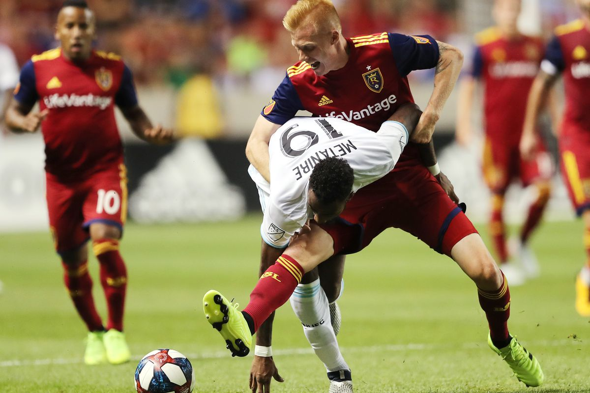 Real Salt Lake defender Justen Glad (15) battles Minnesota United defender Romain Metanire (19) for the ball as Real Salt Lake and Minnesota play in an MLS soccer match at Rio Tinto Stadium in Sandy on Saturday, July 20, 2019. The two teams played to a 1-