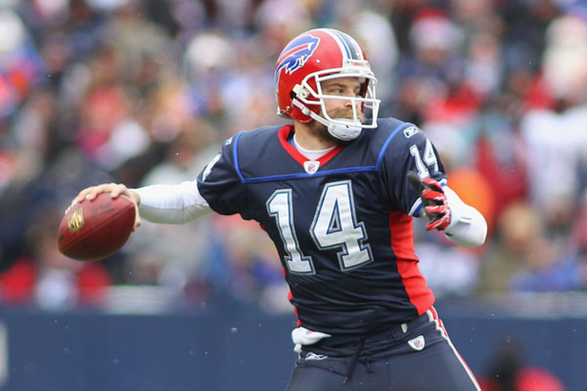 ORCHARD PARK NY - DECEMBER 26:  Ryan Fitzpatrick #14 of the Buffalo Bills readies to pass against the New England Patriots at Ralph Wilson Stadium on December 26 2010 in Orchard Park New York.  (Photo by Rick Stewart/Getty Images)