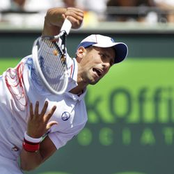 Novak Djokovic, of Serbia, serves to Andy Murray, of Great Britain, during the men's singles final match at the Sony Ericsson Open tennis tournament on Sunday, April 1, 2012, in Key Biscayne, Fla.