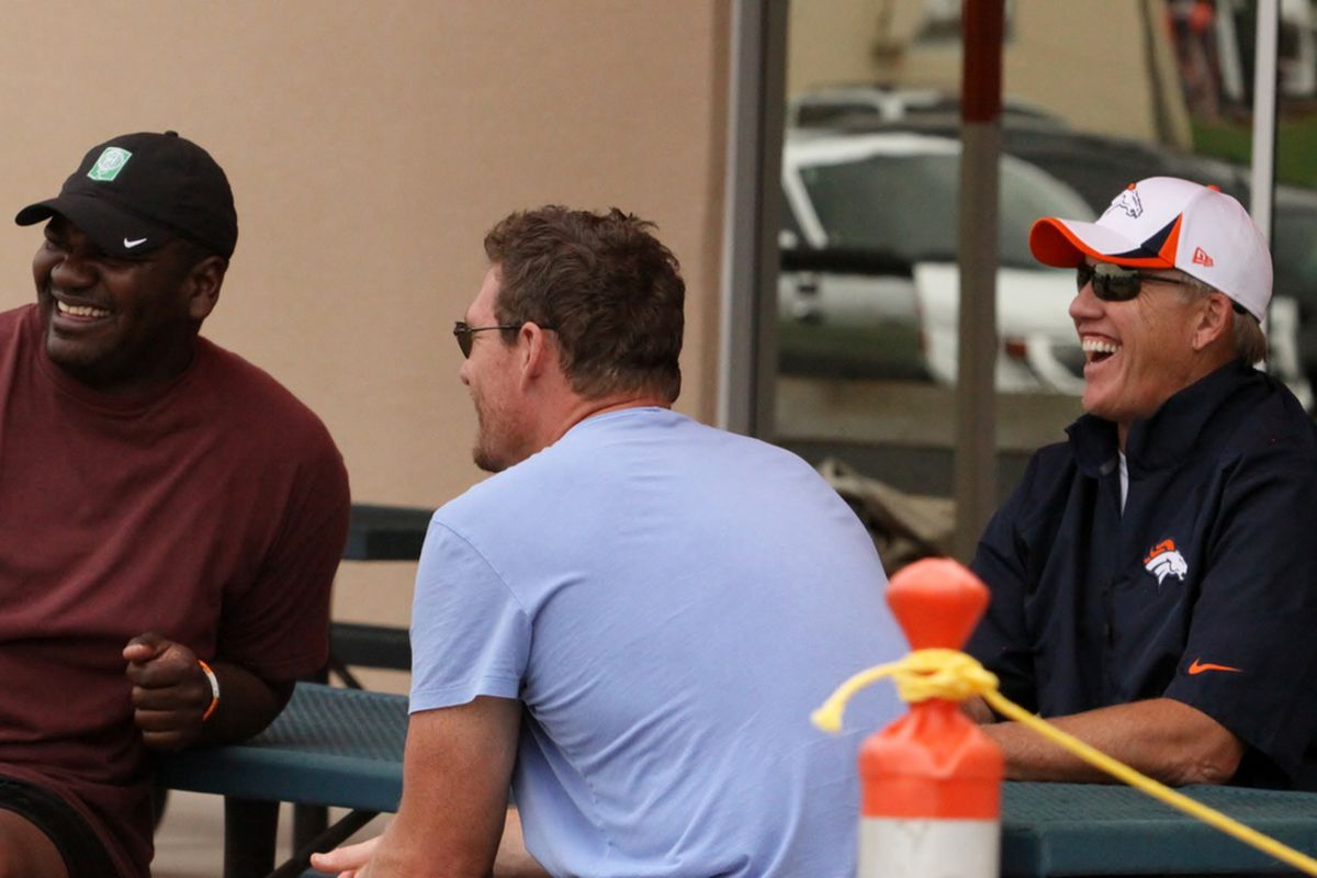 Big Al Williams (left), Tom Nalen (center), and John Elway (right) reminisce as they watch Broncos training camp practice Monday July 29, 2013.