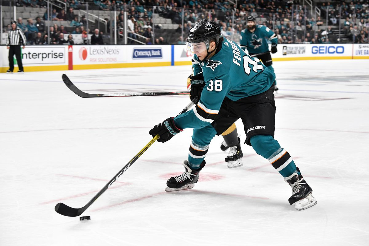 Mario Ferraro #38 of the San Jose Sharks skates ahead with the puck against the Vegas Golden Knights at SAP Center on October 4, 2019 in San Jose, California.