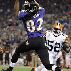 Baltimore Ravens wide receiver Torrey Smith (82) pulls in a touchdown pass under pressure from Cleveland Browns middle linebacker D'Qwell Jackson (52) during the first half of an NFL football game in Baltimore, Thursday, Sept. 27, 2012.