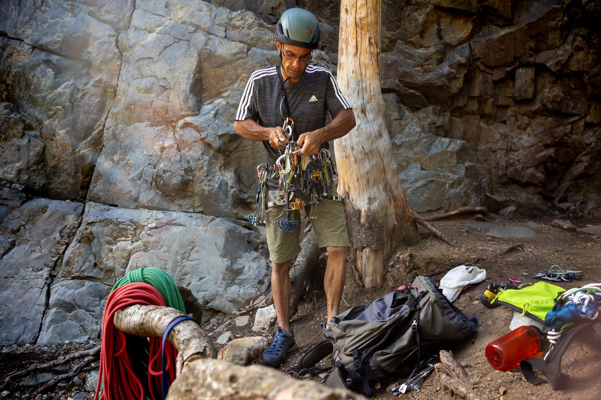 Quino Gonzalez, a guide and instructor for Utah Mountain Adventures, racks up at the start of a trad climbing clinic in Big Cottonwood Canyon on Saturday, July 31, 2021.