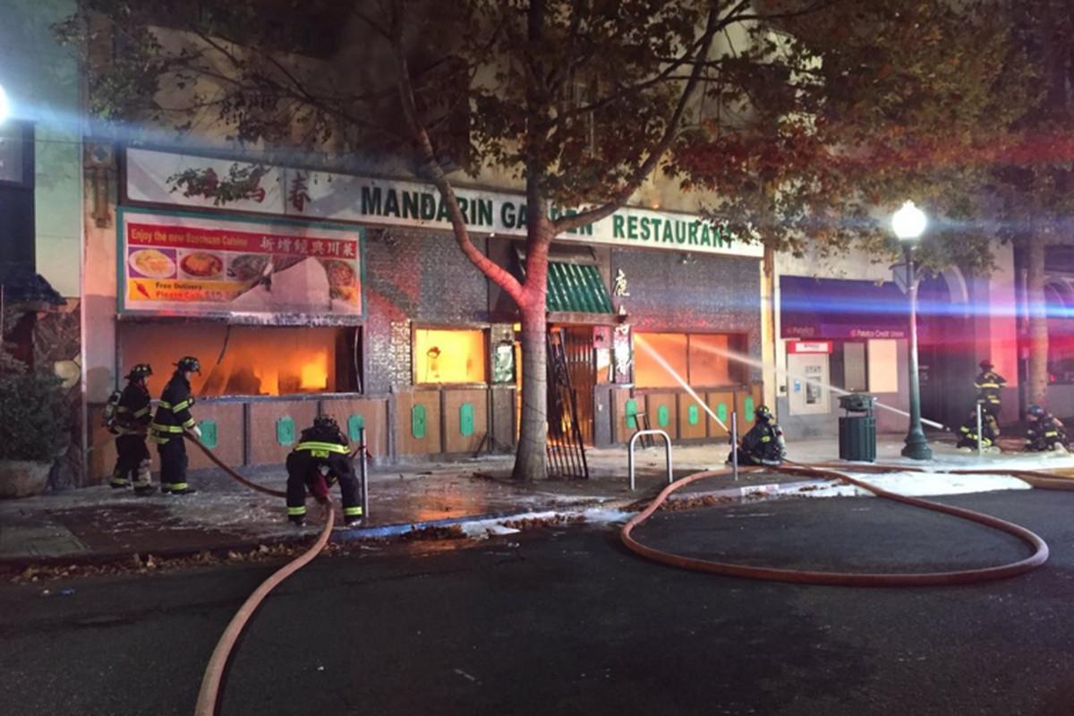 Firefighters battle a two-alarm fire at Mandarin Garden