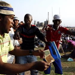 Miners sing and dance in Lonmin Platinum Mine near Rustenburg, South Africa, Tuesday, Sept. 18, 2012. Striking miners have accepted a company offer of a 22% overall pay increase to end more than five weeks of crippling and bloody industrial action.